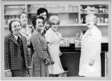 Sr. Anna Foley, right, with group in a lab, Providence Hospital, Oakland, California, ca. 1973