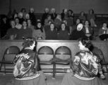 Cheerleaders and stands at a basketball game, Our Lady of Lourdes Academy, Wallace, Idaho, 1954