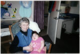 Sr. Lucy St. Hilaire holding a child at Providence Child Center, Portland, Oregon, ca. 1989