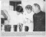 Finishing dinner preparations for open house of St. Edward Hall, John F. Kennedy Memorial High School, Burien,...