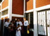 Sisters visiting with neighbors, La Papalota, San Salvador, El Salvador, 1996